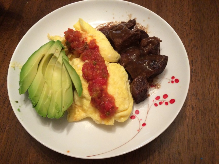 Braised beef, scrambled eggs with salsa and avocado